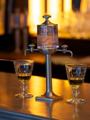 Absinthe fountain on bar counter
