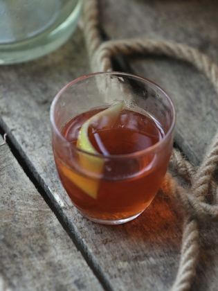 Sazerac cocktail on wooden box with rope