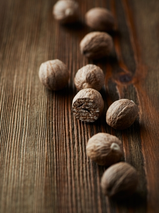 Whole nutmeg on wooden table